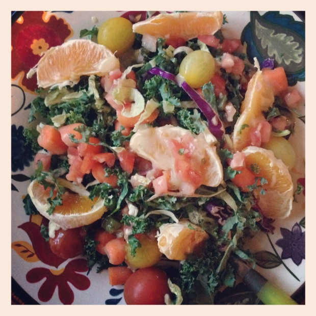 Kale salad with oranges, topped with pear dressing makes a vitamin A and vitamin C-rich meal.