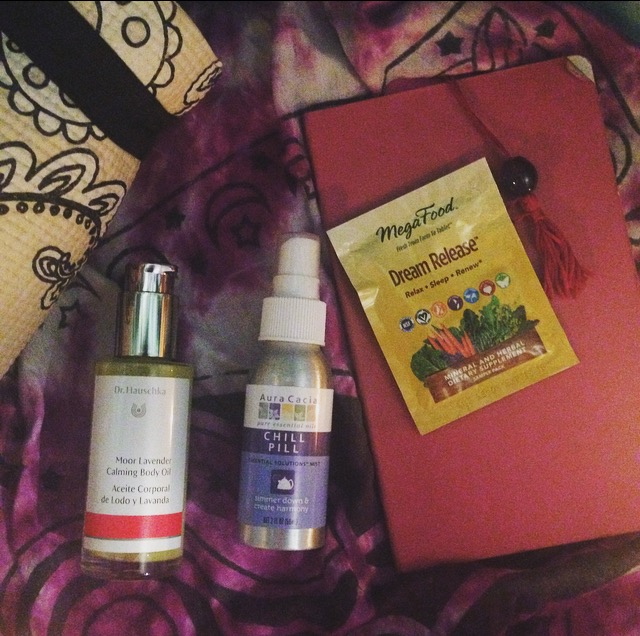 a yoga mat, essential oil lotion + spray, supplements, and a dream journal = a peaceful mind at night.